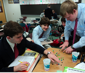 Algebra 2/Trig Honors students use M&M's to explore exponential equations